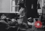 Image of Nurse tending to wounded American soldiers in  World War 1 United States USA, 1918, second 7 stock footage video 65675035179