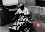 Image of Woman sews Allied flag blanket for Pershing birthday Chicago Illinois USA, 1917, second 2 stock footage video 65675035206