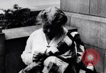 Image of Woman sews Allied flag blanket for Pershing birthday Chicago Illinois USA, 1917, second 8 stock footage video 65675035206