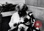 Image of Woman sews Allied flag blanket for Pershing birthday Chicago Illinois USA, 1917, second 9 stock footage video 65675035206