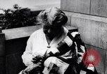 Image of Woman sews Allied flag blanket for Pershing birthday Chicago Illinois USA, 1917, second 10 stock footage video 65675035206