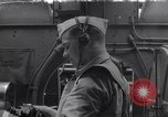 Image of navigator with sextant Pacific Ocean, 1942, second 1 stock footage video 65675035342