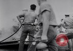 Image of Navy firefighters working at crash sites Pacific Theater, 1942, second 10 stock footage video 65675035347