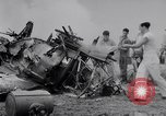 Image of Navy firefighters working at crash sites Pacific Theater, 1942, second 11 stock footage video 65675035347