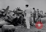 Image of Navy firefighters working at crash sites Pacific Theater, 1942, second 12 stock footage video 65675035347