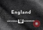 Image of electric motorcycle London England United Kingdom, 1967, second 1 stock footage video 65675035372