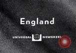 Image of electric motorcycle London England United Kingdom, 1967, second 2 stock footage video 65675035372