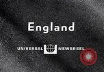 Image of electric motorcycle London England United Kingdom, 1967, second 3 stock footage video 65675035372