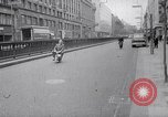Image of electric motorcycle London England United Kingdom, 1967, second 4 stock footage video 65675035372