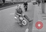 Image of electric motorcycle London England United Kingdom, 1967, second 7 stock footage video 65675035372