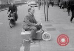 Image of electric motorcycle London England United Kingdom, 1967, second 8 stock footage video 65675035372