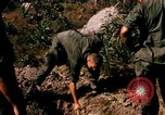 Image of US troops digging foxholes during Operation Big Spring  Vietnam, 1967, second 9 stock footage video 65675035381