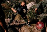 Image of US troops digging foxholes during Operation Big Spring  Vietnam, 1967, second 10 stock footage video 65675035381