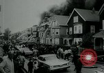 Image of Twenty-three tenement houses consumed by fire in Dorchester area of Boston Boston Massachusetts USA, 1964, second 7 stock footage video 65675035421