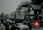 Image of Twenty-three tenement houses consumed by fire in Dorchester area of Boston Boston Massachusetts USA, 1964, second 8 stock footage video 65675035421