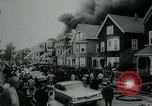 Image of Twenty-three tenement houses consumed by fire in Dorchester area of Boston Boston Massachusetts USA, 1964, second 9 stock footage video 65675035421