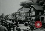 Image of Twenty-three tenement houses consumed by fire in Dorchester area of Boston Boston Massachusetts USA, 1964, second 10 stock footage video 65675035421