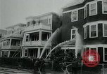 Image of Twenty-three tenement houses consumed by fire in Dorchester area of Boston Boston Massachusetts USA, 1964, second 12 stock footage video 65675035421
