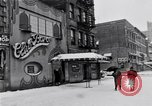 Image of Lenox Avenue, Harlem, New York City, on a snowy day New York City USA, 1963, second 9 stock footage video 65675035550