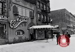 Image of Lenox Avenue, Harlem, New York City, on a snowy day New York City USA, 1963, second 10 stock footage video 65675035550