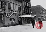 Image of Lenox Avenue, Harlem, New York City, on a snowy day New York City USA, 1963, second 11 stock footage video 65675035550