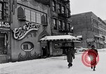 Image of Lenox Avenue, Harlem, New York City, on a snowy day New York City USA, 1963, second 12 stock footage video 65675035550