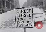 Image of Snow scene in Harlem New York City USA, 1963, second 2 stock footage video 65675035556