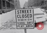 Image of Snow scene in Harlem New York City USA, 1963, second 3 stock footage video 65675035556