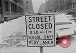 Image of Snow scene in Harlem New York City USA, 1963, second 5 stock footage video 65675035556