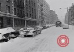 Image of Snow scene in Harlem New York City USA, 1963, second 12 stock footage video 65675035556