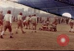 Image of Football field in racecourse infield Tsingtao China, 1946, second 1 stock footage video 65675035638
