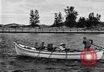 Image of rowing boat New York City USA, 1916, second 11 stock footage video 65675035668