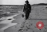 Image of beach patrol men New York City USA, 1916, second 7 stock footage video 65675035669