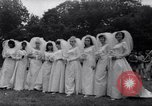 Image of Nine couples marry in Brooklyn's Prospect Park New York City USA, 1967, second 4 stock footage video 65675035699