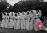 Image of Nine couples marry in Brooklyn's Prospect Park New York City USA, 1967, second 5 stock footage video 65675035699
