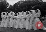 Image of Nine couples marry in Brooklyn's Prospect Park New York City USA, 1967, second 6 stock footage video 65675035699