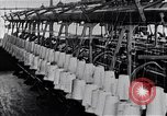 Image of machines and workers manufacturing cloth United States USA, 1920, second 11 stock footage video 65675035761