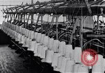 Image of machines and workers manufacturing cloth United States USA, 1920, second 12 stock footage video 65675035761
