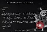 Image of error checking in produced stockings United States USA, 1920, second 6 stock footage video 65675035762