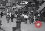 Image of busy market shops and streets Harlem New York City USA, 1937, second 2 stock footage video 65675035839