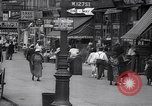 Image of busy market shops and streets Harlem New York City USA, 1937, second 4 stock footage video 65675035839