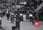 Image of busy market shops and streets Harlem New York City USA, 1937, second 5 stock footage video 65675035839