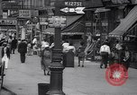 Image of busy market shops and streets Harlem New York City USA, 1937, second 6 stock footage video 65675035839
