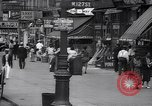 Image of busy market shops and streets Harlem New York City USA, 1937, second 7 stock footage video 65675035839