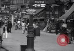 Image of busy market shops and streets Harlem New York City USA, 1937, second 8 stock footage video 65675035839