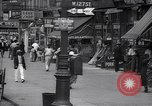 Image of busy market shops and streets Harlem New York City USA, 1937, second 9 stock footage video 65675035839