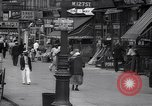 Image of busy market shops and streets Harlem New York City USA, 1937, second 10 stock footage video 65675035839