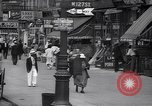 Image of busy market shops and streets Harlem New York City USA, 1937, second 11 stock footage video 65675035839