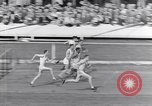Image of track events between USA and Britain London England United Kingdom, 1936, second 10 stock footage video 65675035856