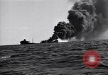 Image of sinking burning ship Atlantic Ocean off New Jersey USA, 1942, second 4 stock footage video 65675035894